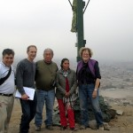 Willie, Duane, Padre Benjamin, Carmina and Karen pose by the cross on the hill.