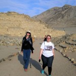 Lydia and Jessica walk through Caral.