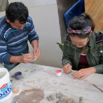 Roberto and Shina using the colorful paint.