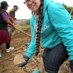 Jessica works alongside community members, helping to remove rocks and other debris to make way for more garden space.