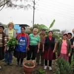 Duane and Karen pose with community gardeners.