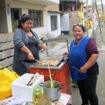 Alicia and helper prepare the anticuchos.
