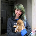 Lydia with one of three new puppies at Alicia's house.