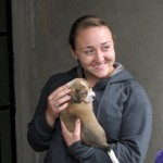 Danielle holds one of three new puppies recently born at Alicia's house.