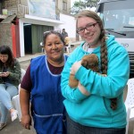 Alicia and Jessica, with one of three puppies recently born at Alicia's house.