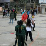 Elizabeth with new friends on the playground.