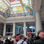 Students inside the Casa de la Literatura with its elegant Art Nouveau interior, and stained-glass skylight.