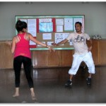 Pedro Farias and his partner demonstrate a Peruvian dance for the students.