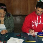 Shina and Trevor concentrate on jewelry making.