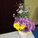One of the floral arrangements decorating the tables, taken home at the end of the evening as a thank you gift.