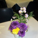 One of the floral arrangements decorating the tables, taken home by host families at the end of the evening.
