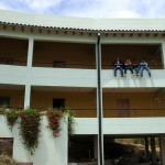 Four GC chicos line up outside their hotel room in the town of San Jeronimo outside Cusco.