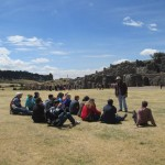 Students listen to our guide, Abraham, before exploring Sacsayhuamán.