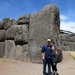 Bryan and Danielle pose by one of the largest stones at Sacsayhuamán, which they say weighs more than 300 tons.
