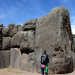 Lydia poses by one of the largest stones at Sacsayhuamán, which they say weighs more than 300 tons.