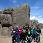 GC women pose for a group photo at Sacsayhuamán in front of one of the largest stones.
