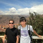 Max and Armando  pose overlooking the city of Cusco from Sacsayhuamán.