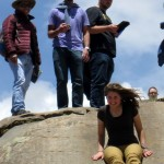 Elizabeth slides down the rocks at Sacsayhuamán.