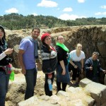 Lydia, Trevor, Frances, Jessica, Danielle and Willy head into a cave at Sacsayhuamán.