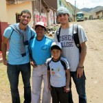 Trevor and Armando posed with their host family in Lucre.