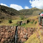 Climbing by irrigation channels at Tipón.