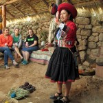 A Chinchero weaver, Tania, gives a presentation on how wool is prepared for weaving.