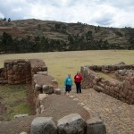 Jessica and Adriene make their way to the colonial-era church at Chinchero.
