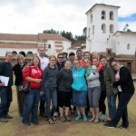 The group poses for a photo in front of the church at Chinchero.