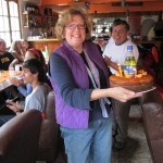 Karen carries a cake for Jessica, made by one of our host families. Inside is a bottle of Inka Kola.