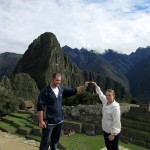 Bryan and Danielle show the shape of the mountains at Machu Picchu.
