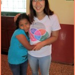 Shina receives a hug from a student at INABIF, her school in San Ramon.