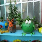 A frog planter made from a soccer ball.