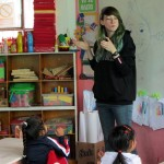 Lydia works with the children in her class on the sign for sandia, or watermelon, in Peruvian Sign Language.