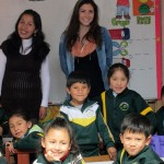 Miss Maddie and Miss Kelly, the Kindergarten teacher pose with the children for a class photo.
