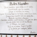Padre Nuestro (The Lord's Prayer) posted on an office door at Promesa school.
