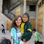 Our daughter, Emily, holding one of the younger Promesa students. Emily is a volunteer at Promesa during her 'gap' year in Peru.