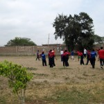 Students at Harvest school playing soccer.
