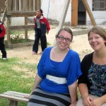 Jessica and Adriene pose in the courtyard of the Harvest school.