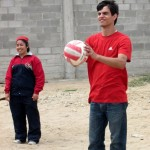 Armando joins the students for a game of volleyball.