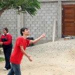 Armando plays volleyball with students at Harvest school.