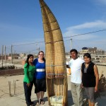 Jessica poses with her Santa Rosa host family by her dad's fishing boat, a caballito de totora, or reed boat.