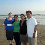 Jessica poses with her host family on the beach in Santa Rosa.