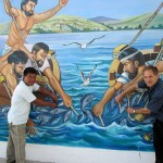 Jessica's host dad, Juan Carlos, and Duane pose for a picture by a mural at a plaza in Santa Rosa.