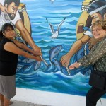 Jessica's host mom, and Karen pose for a picture by a mural at a plaza in Santa Rosa.