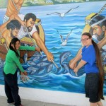 Jessica and her host sister, Jhomira, pose for a picture by a mural at a plaza in Santa Rosa.