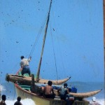 A picture of fishermen heading out to see with their reed boats in Pimentel.