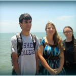 Armando, Adriene and Jessica pose at the end of the (very long) pier in Pimentel.