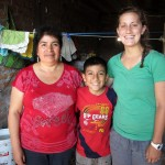 Mariah's host mother and brother pose for a photo after a Pachamanca lunch.