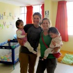 Elizabeth poses with fellow SSTer, Mariah, and twin girls who live at Casa Hogar in Ayacucho.