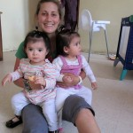 Mariah with twin girls, just over a year old, at Casa Hogar orphanage.